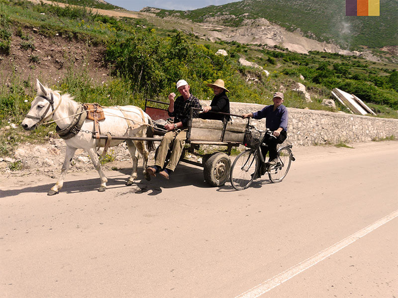 Locals on a horse and cart spotted during a cycling holiday in Albania