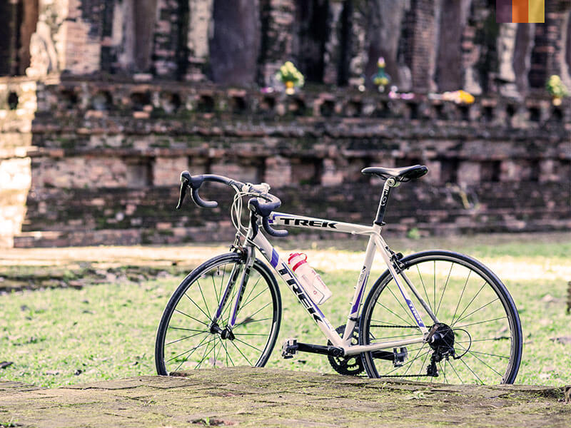 A road bike leaning up against Angkor Wat in Cambodia