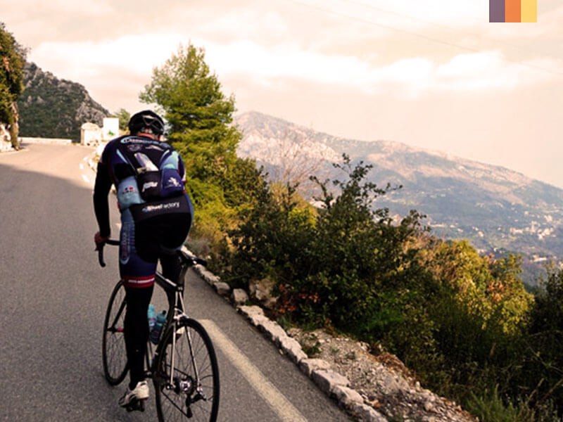 Cyclist riding up the Col de la Madone in France