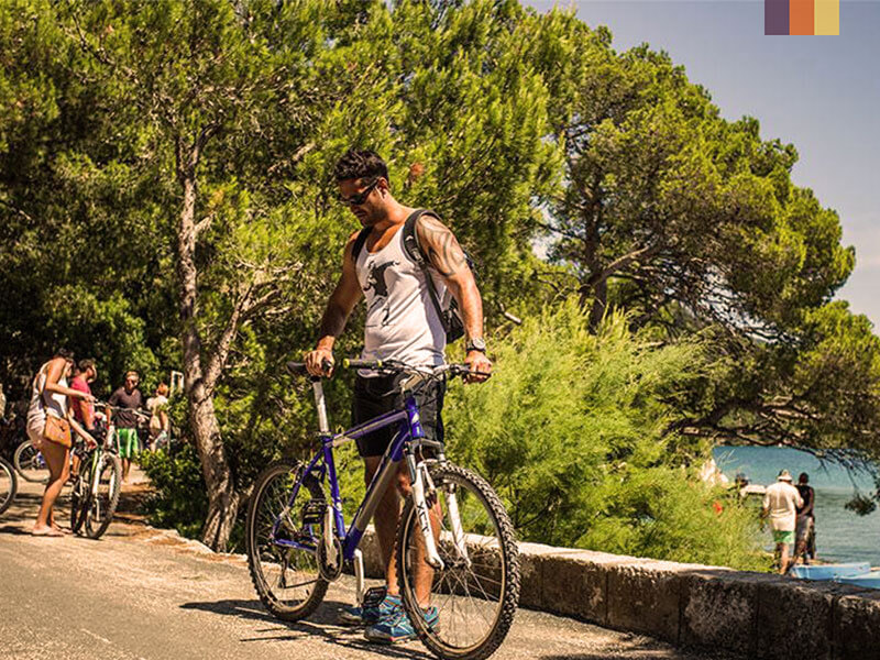 A man adjusting his bike on a cycling holiday in Instria Croatia