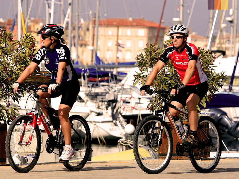 Two cyclists in Croatia cycling around the bay