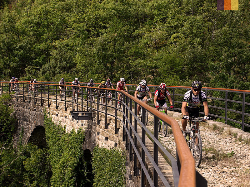 A group of cyclists crossing a bridge in Dubrovnik on their cycling holiday in Croatia