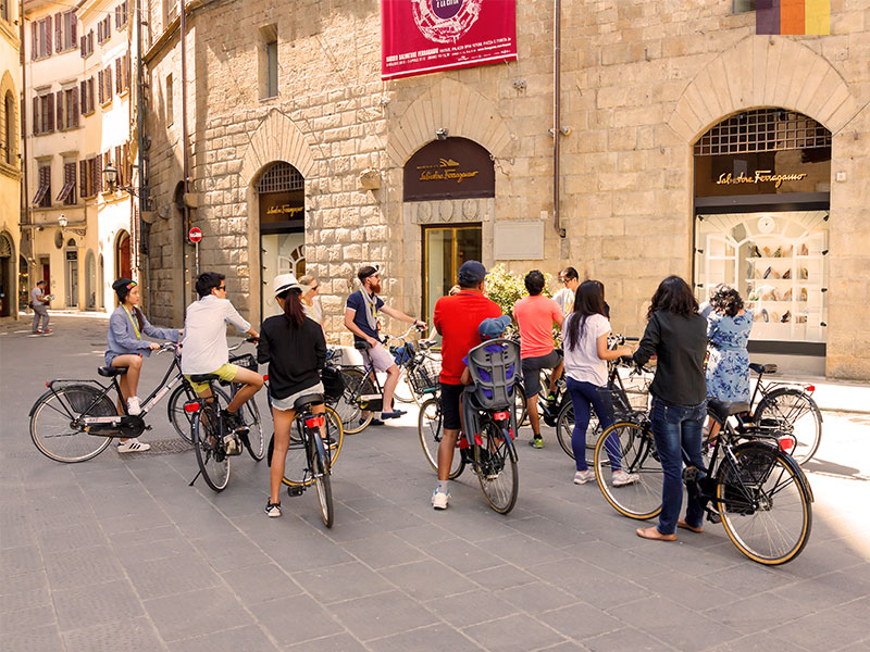 A group of cyclists enjoying the sights in Florence Italy