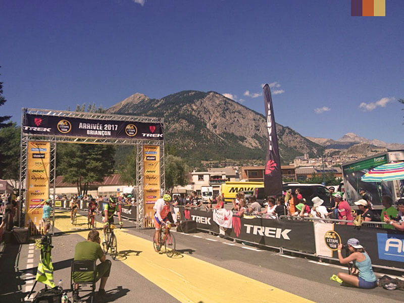 Cyclist riding under the arrival sign of the Etape du Tour 2017 in Briancon, France