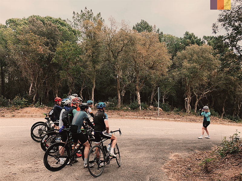 group looking over the sea in Spain on a cycling holiday