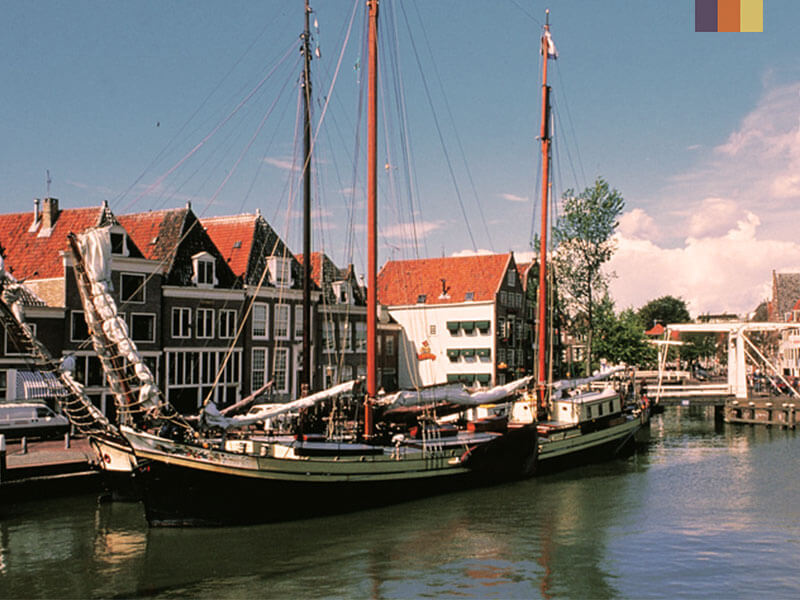 two sailing boats on a river in a small Dutch town, taken on a cycling holiday