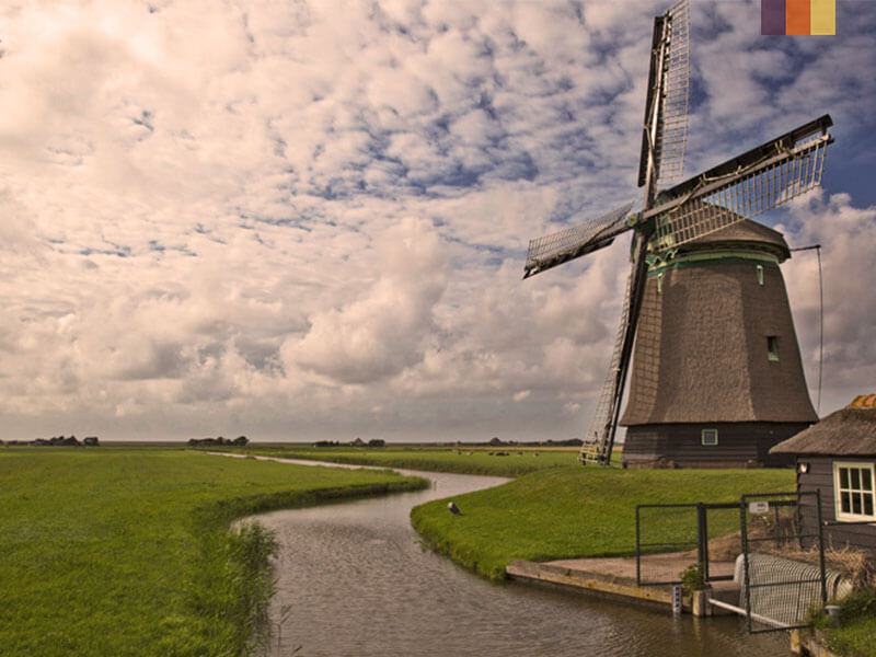 A windmill in Holland on a cycling holiday of sand dunes and deltaworks