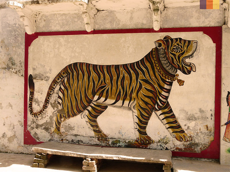 Street art painting of a tiger seen on a India cycling holiday