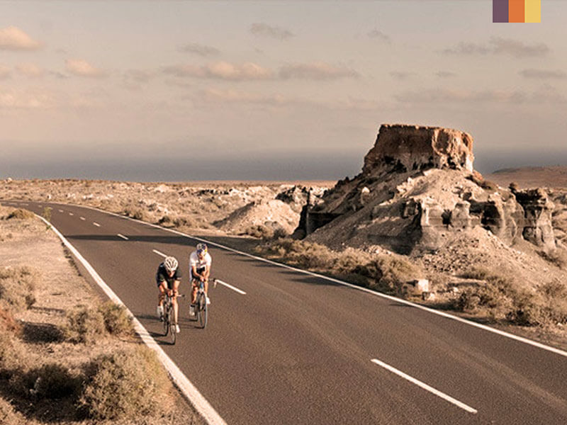Two cyclists in Timanfaya National Park on a Lanzarote cycling holiday