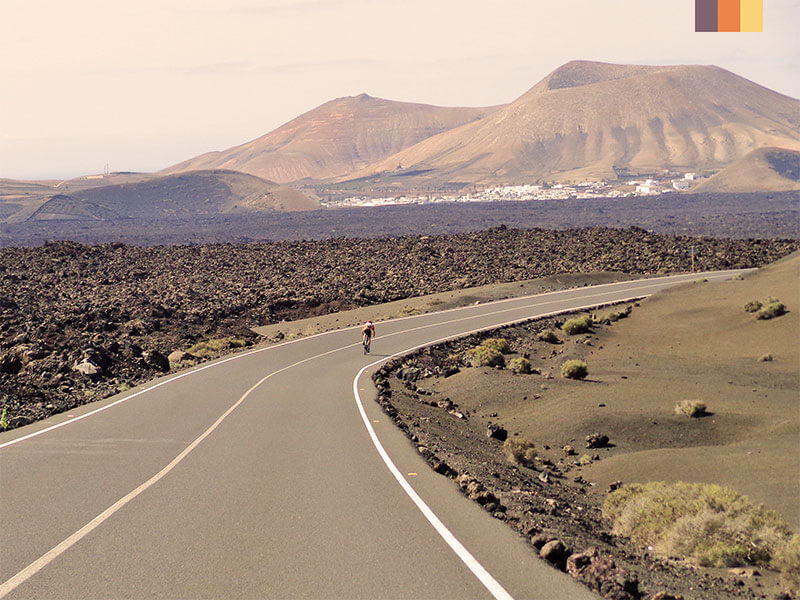 A lone cyclist on the Montanas del Fuego on a Lanzarote cycling holiday
