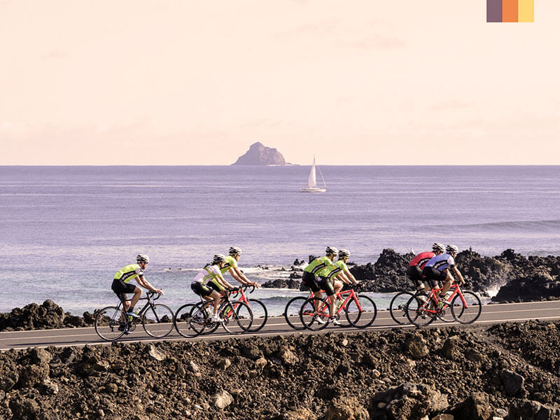 A group of cyclings riding along the coast in Lanzarote on their cycling holiday