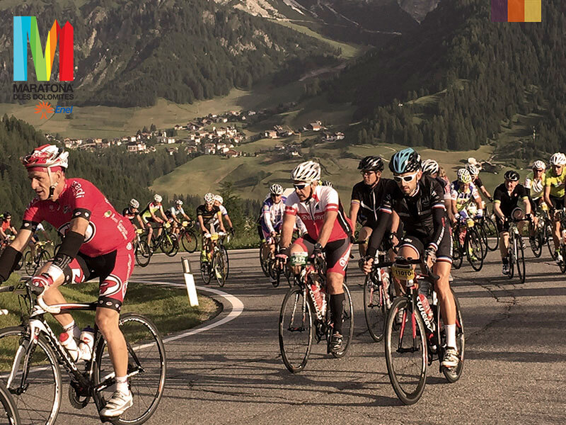 Cyclists going round a corner in the Maratona dles Dolomites
