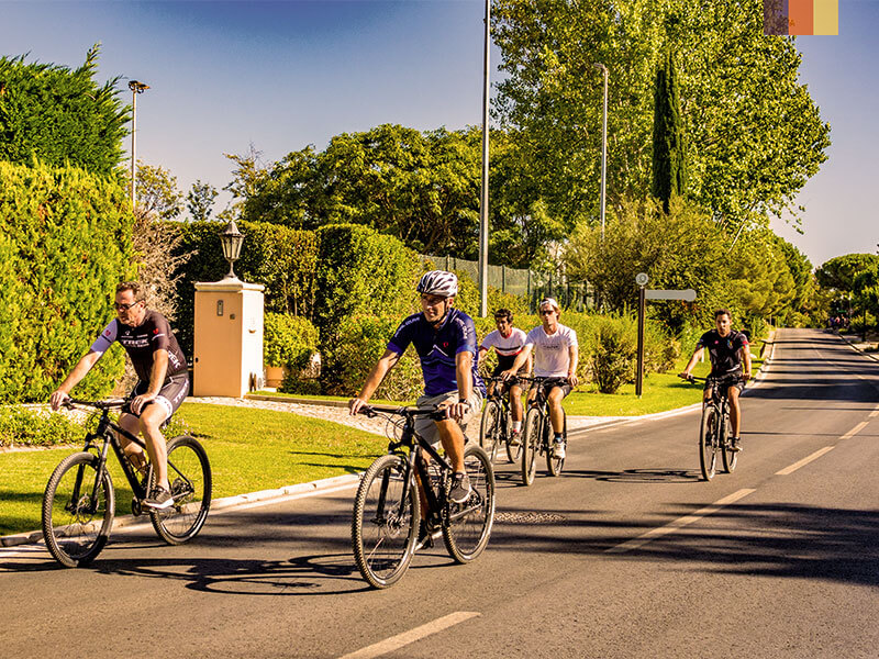 A group of cyclists along a road on a cycling holiday to the Algarve Portugal