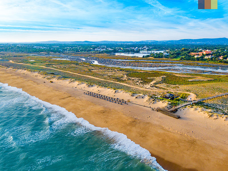 Aerial view of dandy beaches and land in the Algarve Portugal