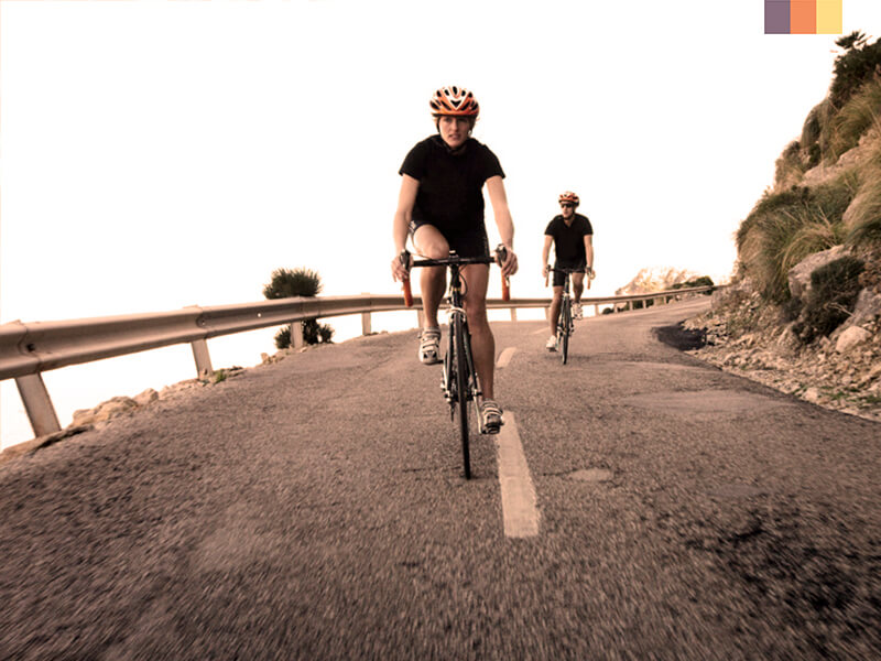 Two cyclists on the road on a Port Pollensa cycling holiday