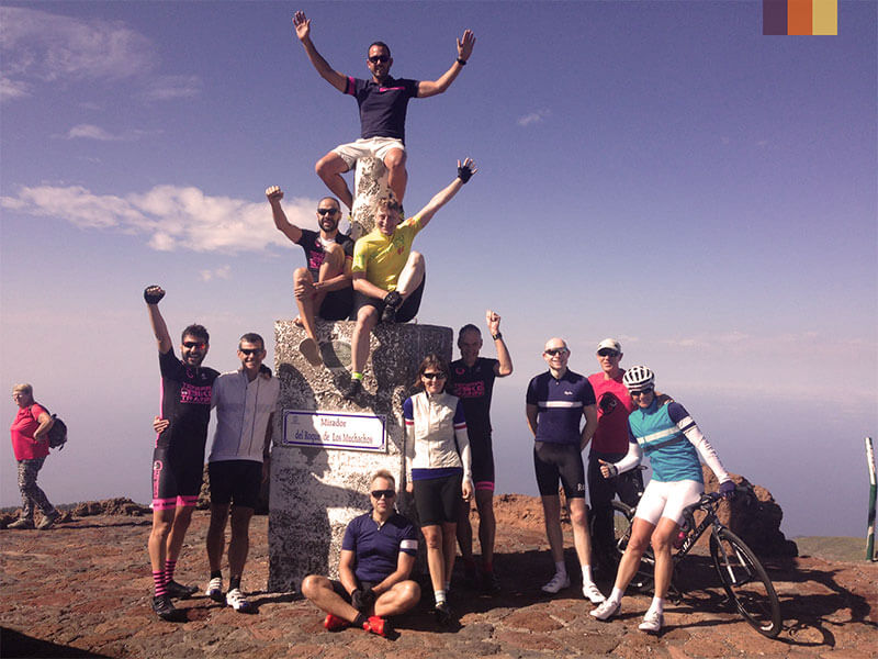 A group of cyclists at the Mirador del Roque de Los Muchachos viewpoint on their Tenerife cycling holiday