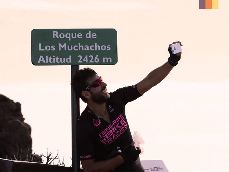 A cyclist taking a selfie in front of Roque de los Muchachos on his Tenerife cycling holiday