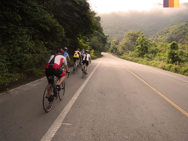 A group of road cyclists enjoying their cycling holiday from Bangkok to Phuket
