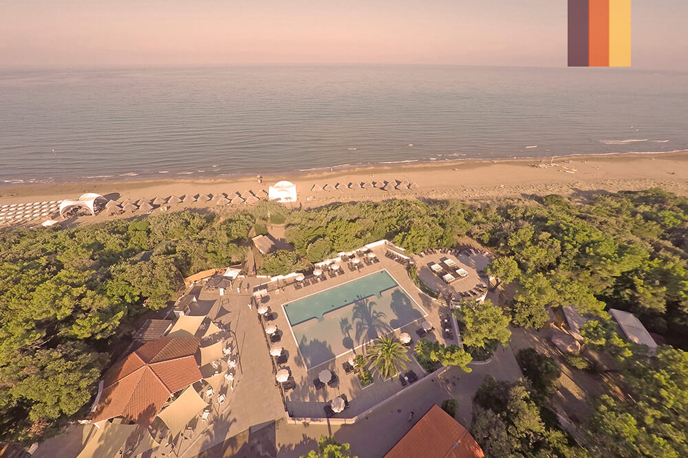 Aerial view of Paradu eco resort with a beach and swimming pool