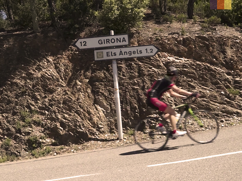 A cyclist riding up the Els Angels climb in Girona